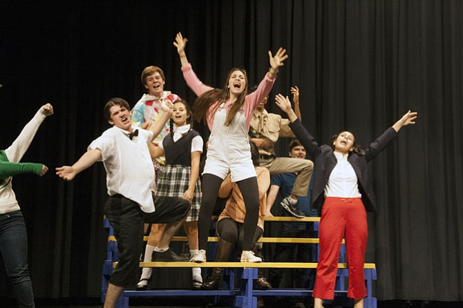 Langley High School Saxon Stage actors take a leap off the bleachers during rehearsal for The 25th Annual Putnam County Spelling Bee.