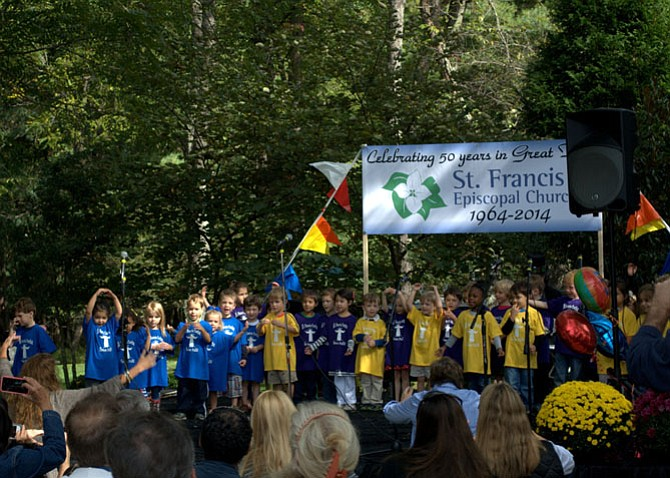 Students of St. Francis Creche preschool sang at the St. Francis Fair.