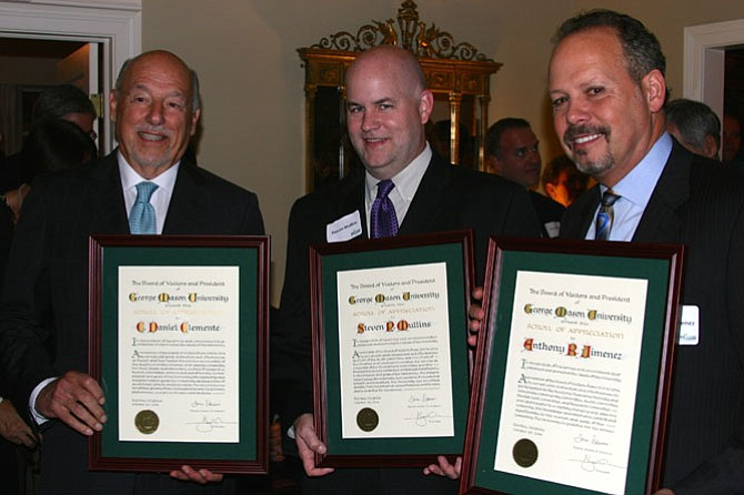 From left: Former Rector C. Daniel Clemente and former Board of Visitors members Steven Mullins and Anthony Jimenez receive honors for their terms.