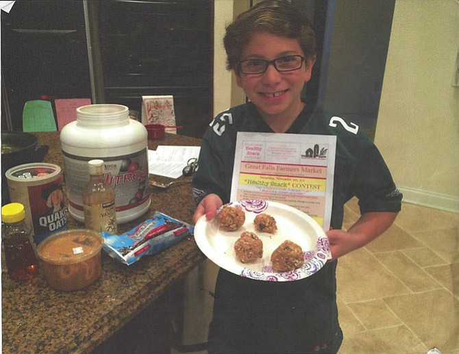 "Alex Bartolozzi with all his healthy ingredients and his completed ""Protein Balls."""