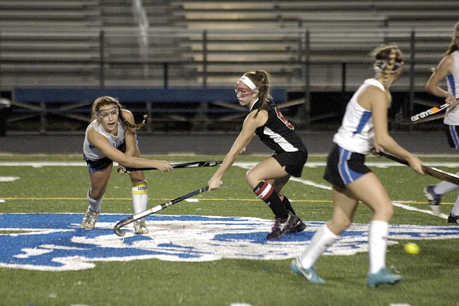 Fairfax senior captain Meg Robertson, left, scored the game-winning goal against Herndon in the 6A North region semifinals on Tuesday night at Fairfax High School.