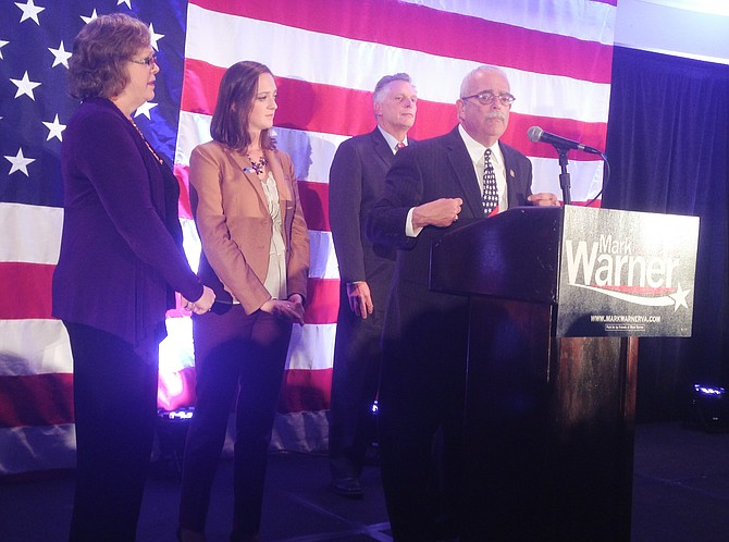 Congressman Gerry Connolly, flanked by his wife Cathy, his daughter Caitlin, and Virginia Governor Terry McAuliffe delivers his victory speech at a Democratic Election Night gathering in Arlington. Connolly was elected to a fourth term in the U.S. House of Representatives. It marked his 10th consecutive election victory.