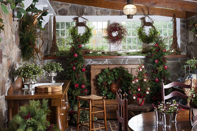 Custom Wreaths of Potomac, which is located on the bottom level of Linda Hobbins' carriage house, has been transformed into a holiday wonderland.