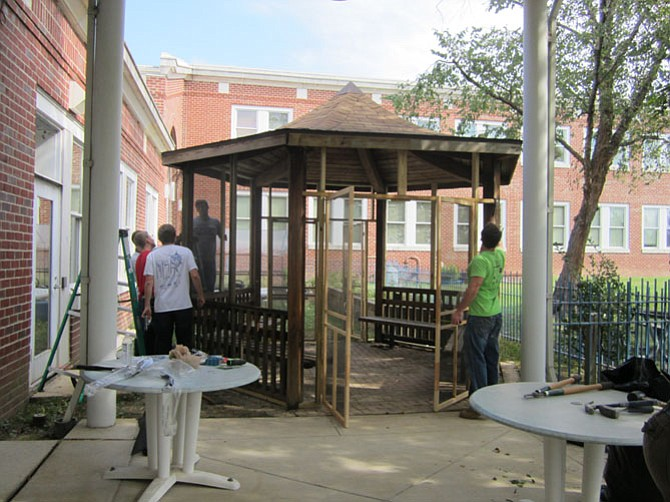 Volunteers construct a gazebo at the Adult Day Services Center.