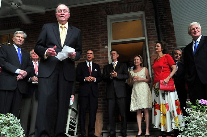 Former U.S. Ambassador to NATO David Abshire introduces Don Beyer and his wife Megan to guests at a party given at his Old Town residence in August of 2009. Beyer had been just been sworn in as U.S. Ambassador to Switzerland and Liechtenstein. Joining Ambassadors Abshire and Beyer on the porch were U.S. Sen. John Warner, SCAN founder David Cleary, former Virginia Gov. Chuck Robb, Don and Megan Beyer, Linda Robb and U.S. Rep. Jim Moran.