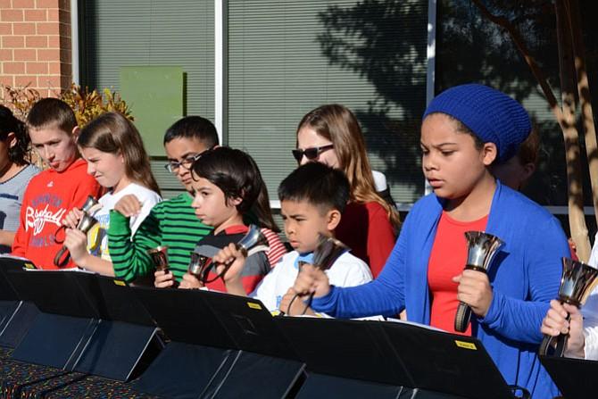 (From left) Sangster hand bell choir members Ethan Duke, Phoebe Shudt, Saifullah Naseer, Alex Coley, Jenna Kosnick, Andrew Agustin and Courtney Cooper perform on Veterans Day.