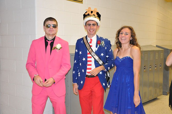 "Headed from the dance, Kevin Deely, Johnny Pace, and McKinsey Smith pose for a picture. ""We had to get there early for the announcing of the court, so as the dance was ending we were so excited to leave,"" said Smith."