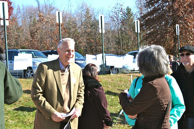 Al Johnson, who lost the Republican primary on Saturday, talking to voters outside the polls.