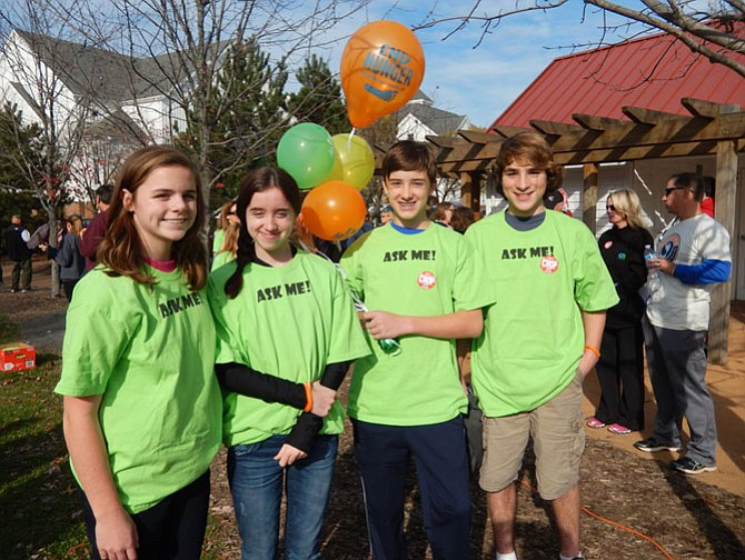 Two sets of twins from Thoreau Middle help at the walk. (From left) are Lianna Williams, Hannah Rupy, Noah Rupy and Miller Williams.