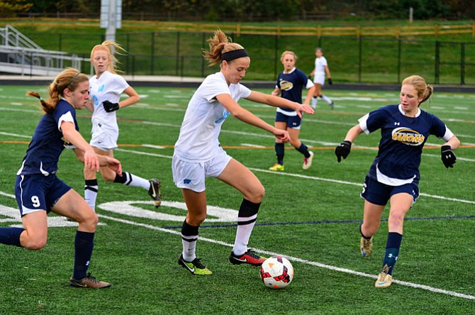Sophomore forward Abby Meyers, seen against B-CC in the section final on Oct. 31, and the Whitman girls' soccer team finished the 2014 season with an undefeated record.