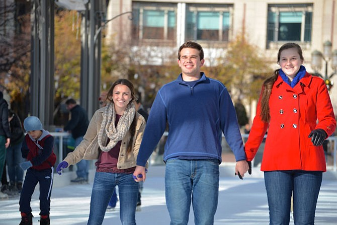 From left -- Rylee McKeon, James Drasbeck and Caroline Drasbeck from Great Falls, decided that literally sticking together was the best way for everyone to stay upright on the ice. Their theory seemed to work.