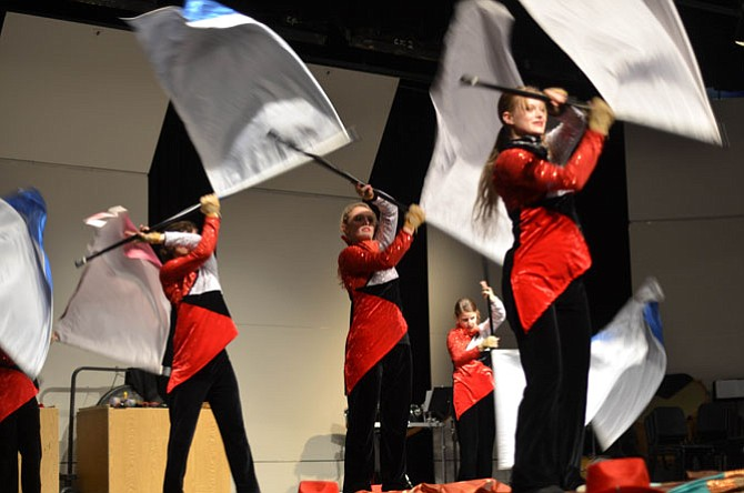 In addition to music from the Herndon High wind ensemble, the Nov. 12 evening concert also featured a show by the marching band and color guard.