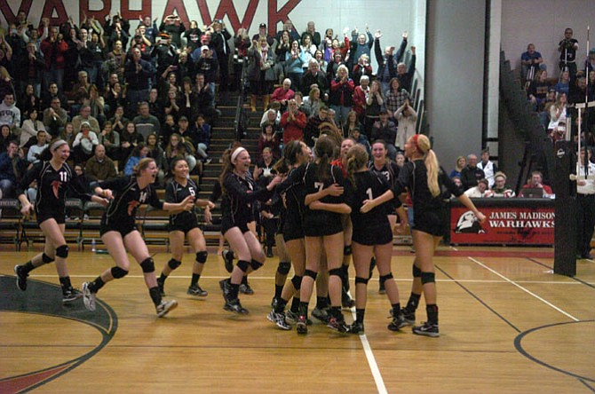 Madison volleyball players celebrate their sweep of Osbourn Park in the region semifinals on Nov. 15.
