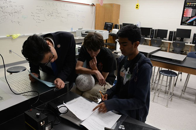 From left: Justin Yum of Woodbridge, Jacob Benheim of Fairfax, Nihar Gudiseva of Herndon study after school last fall in TJHSST new wing's quantum physics and optics lab.