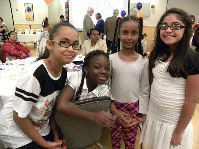 From left, Lina Bedawi, 11, Naana Boateng, 9, Ruba Bedawi, 7, Zoya Khan, 10, of Fairfax entertain guests with a choreographed dance at Facets' 15th Annual Taste of Fall on Saturday, Nov. 15 in Fairfax.