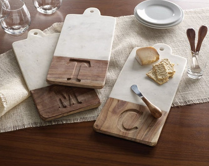 Luxurious white marble and natural wood make these cheese boards an elegant gift.
