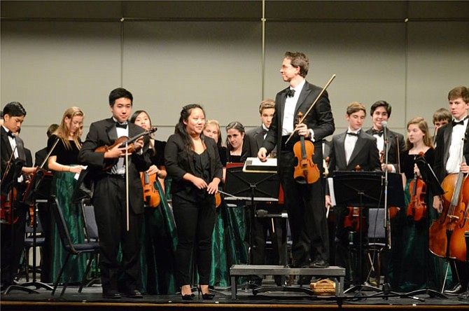 """At the finale of """"An Evening in Vienna,"""" the Concert Orchestra and Langley HS Orchestra Directors Elizabeth Leung and Dr. Scott McCormick acknowledge applause."""