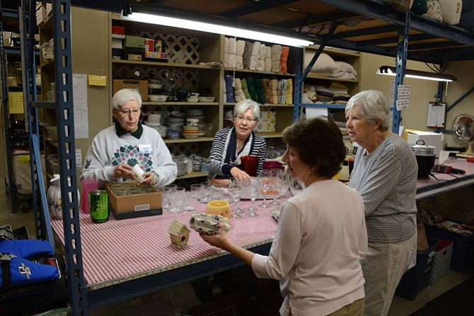 (Clockwise from top left) ECHO volunteers Pat Norton of Springfield, Eileen McGirl of Burke, Patsy Maddox of Fairfax and Jean Chandler of Burke assess and sort donated kitchen wares.