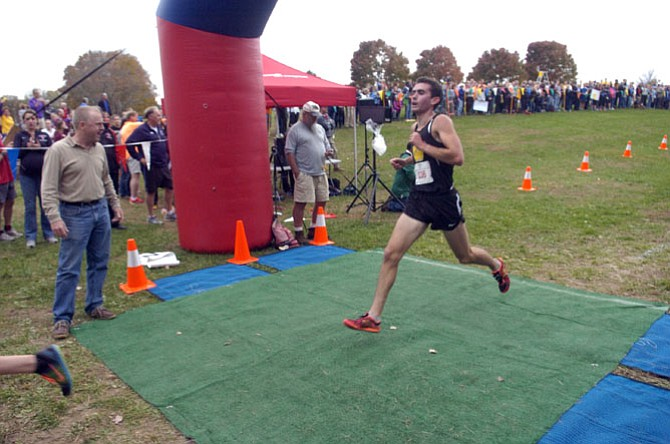 Westfield senior Johnny Pace crosses the finish line at the 6A North region championship meet on Nov. 5 at Burke Lake Park.