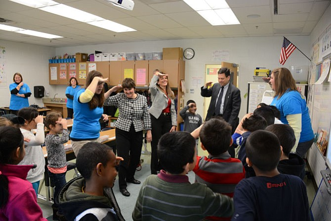 "Hybla Valley Elementary School students in Megan Sidari's (right) second grade class teach Virginia Secretary of Education Anne Holton (rear left), FCPS School Board Chairman Tammy Derenak Kaufax (rear center) and 44th District Delegate Scott Surovell (rear right) their ""Shark Attack"" song."