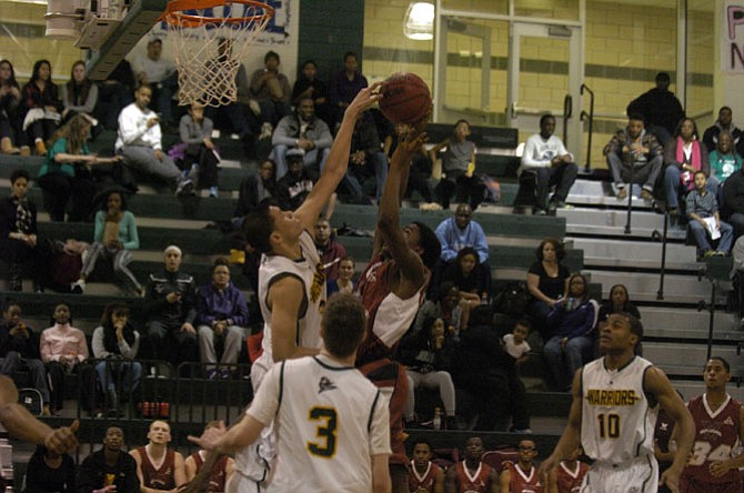Wakefield's Dominique Tham, left, blocks a shot against Mount Vernon last season.