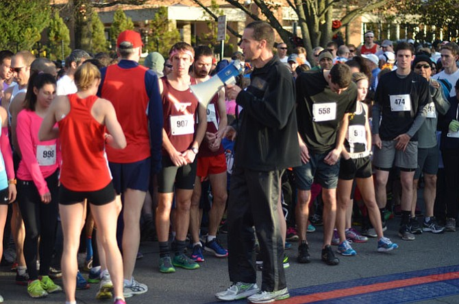 Wolf Gottschalk uses a loudspeaker to tell participants in the Herndon Turkey Trot 5K about the race course. Over 1,100 runners, eight elementary school running groups, 50 plus volunteers, Town of Herndon staff, and many local and national sponsors contributed to the success of the race.