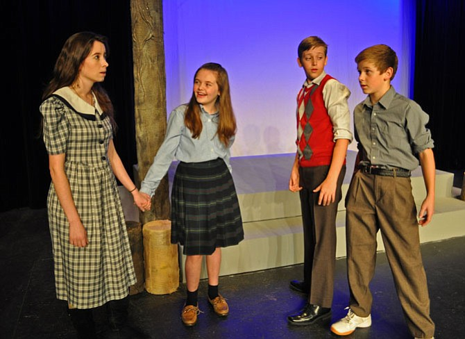 From left -- Rachel Yeager (Susan), Kyleigh Friel (Lucy), Ethan Phillips (Peter) and Nicholas Carlin (Edmund) in an early rehearsal for the C.S. Lewis classic 'The Lion, the Witch and the Wardrobe' from the Providence Players.