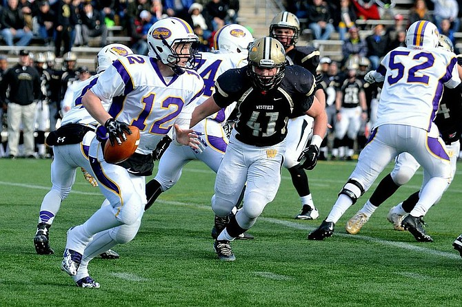 Westfield linebacker Jack Clancy (41) sets his sights on stopping Lake Braddock quarterback Kyle Edwards during the 6A North region semifinals on Nov. 29.