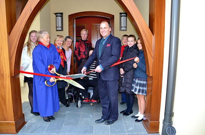 Ribbon cutting starting the Woman's Club of McLean's 48th annual Holiday Homes Tour