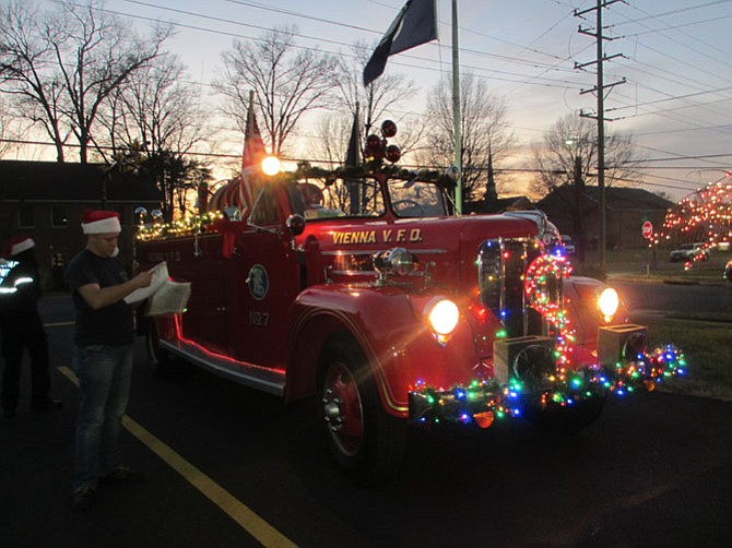 Santa's antique fire truck is aglow for its evening runs through Vienna.