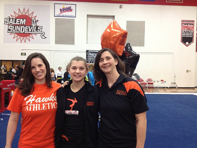 Hayfield's Molly Overstreet, middle, is a two-time VHSL state champion gymnast. Her mother, Kristin Overstreet, right, is an assistant coach with the Hawks. Also pictured is Hayfield head coach Michelle Pennow.