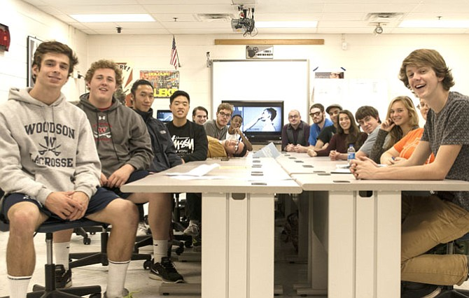 Pictured are Fairfax Academy students in teacher Matthew Balthrop's Professional Television Production class, with a still scene from one of their horror films in the background.