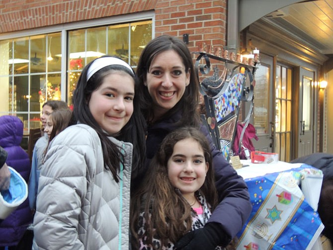 Melissa Levine with daughters Lexie and Sloan at the Menorah candlelighting in Potomac Village.