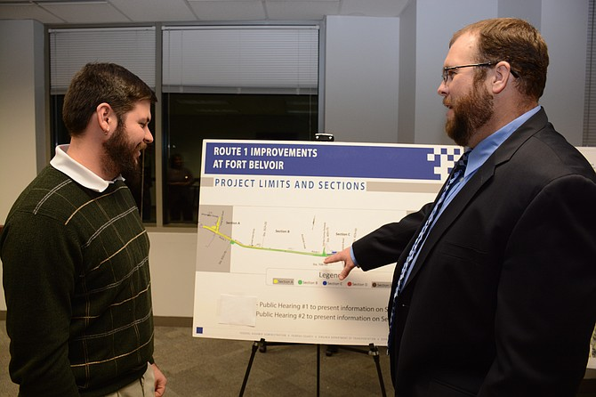 Tim Brown (right) with the Eastern Federal Lands Highway Division of the Federal Highway Administration points out the five areas of U.S. Route 1 improvements to Adam Vencill, a project team member who lives in Maryland.