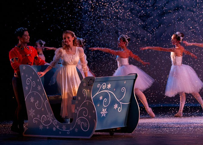 Camille Pukall, of Vienna and McLean High, as Clara arrives to the Kingdom of Snow with the Nutcracker Prince, portrayed by Gillmer Duran, CBT's Ballet Master and Guest Artist in Residence.