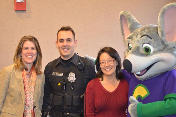 Town of Herndon Vice Mayor Jennifer K. Baker with Herndon Police Officer Monahan, Herndon town council member Grace H. Wolf and Chuck E. Cheese at the December Cops & Kids event, hosted at Herndon Police Department in Herndon, VA.