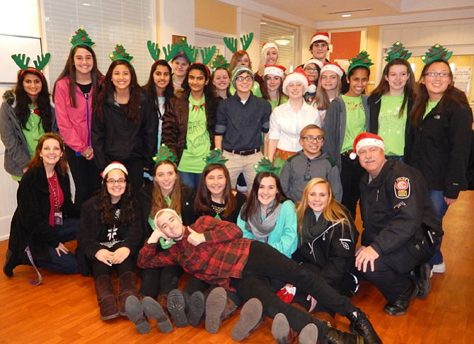 Chantilly and Centreville high-school students, teacher Betty Simmons (kneeling on left) and MPO Wayne Twombly (kneeling on right) brought joy to the Hanley Shelter children.