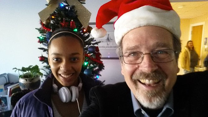 At the Christmas party, the Rev. Keary Kincannon in his Santa hat poses with congregation member Brianna Ford.