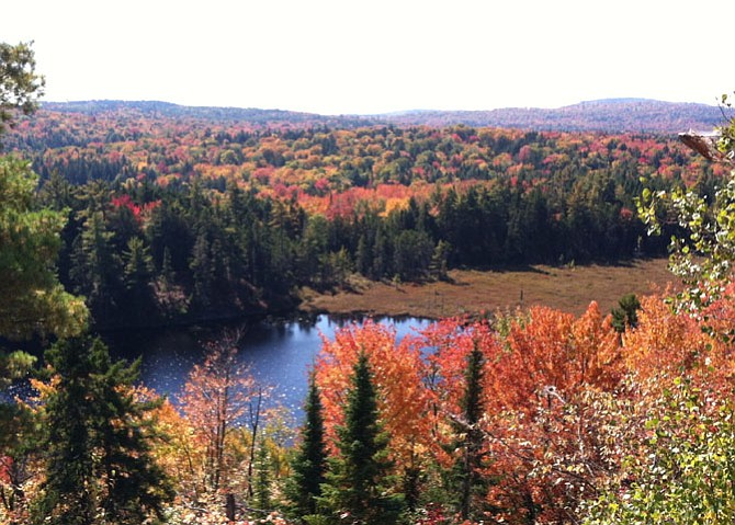 In Maine, with 100 miles to go, the changing foliage shows that summer was over.