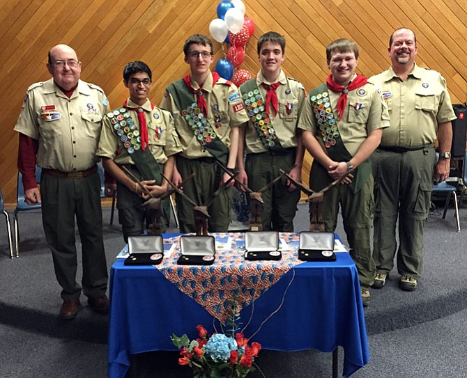 Powhatan District Eagle Advisor Stephen Housley (left) joins Troop 1313 Scoutmaster Vernon Joyner (right) to congratulate Eagle Scouts (from left) Vijay Iyer, Charlie Quinn, Tom Joyner, and Jonathan Lee.
