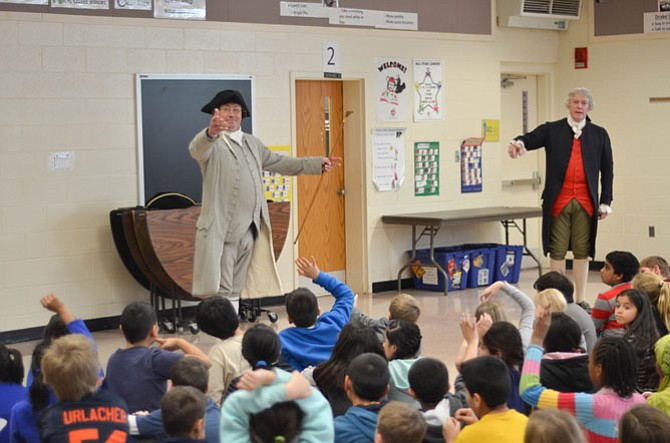 Historical re-enactors Bill Barker and Richard Schumann portrayed Founding Fathers Thomas Jefferson and Patrick Henry in January at several FCPS elementary schools in Reston and Herndon, VA. In this photo they take questions from students at Dranesville Elementary in Herndon.