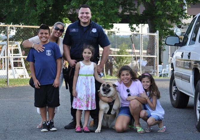 Gracie, Alexandria's first female police K-9, is shown with APD officer Steven Escobar and his family. Gracie died Dec. 24, 2014 from complications from kidney cancer.