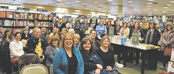 """(Center, from left) Sherry Harris, Maureen Espizito and Sue Carlin sit with friends and family of Harris at the launch of her book """"Tagged For Death"""" in the Fairfax Barnes & Noble."""