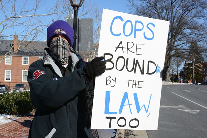 Jason McCormack of Centreville demonstrates for increased police accountability at a Jan. 8 protest in Fairfax.