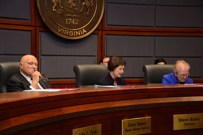 Fairfax County Board of Supervisors chairman Sharon Bulova (center) reads her statement calling for outside input on improving information disclosure policies.