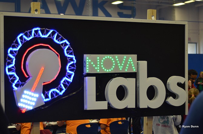 A sign displaying the logo of Nova Labs at the first inaugural NoVA Mini Maker Faire at Reston South Lakes High School. Last year was the first NoVa Mini Maker Faire, which sold over 3,000 tickets, and helped guide visitors to displays related to technology and engineering.