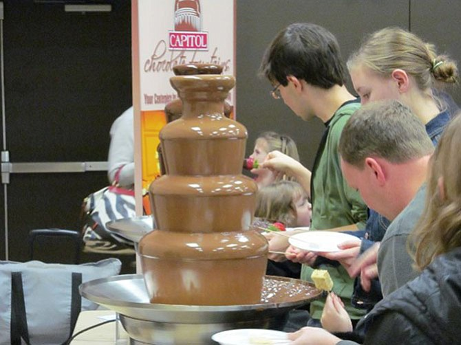 Visitors enjoy a chocolate fountain from Capitol Chocolate Fountains in a past McLean Chocolate Festival. This year's festival will be Sunday, Jan. 25 at McLean Community Center.
