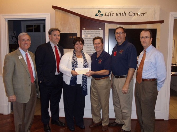 Members of the Clifton Lions Club present a check to Life With Cancer (LWC) at the LWC facility by Fairfax Hospital. (From left) Jay Moughon, Clifton Lions and second vice district governor; Mike Carter, INOVA Health Foundation, director of outreach; Catherine Intartaglia, Life With Cancer, director of development; Jim Chesley, Clifton Lions and Labor Day Car Show organizer; Rich Kurz, Clifton Lions, president; Jim Boatner, Clifton Lions, past president.