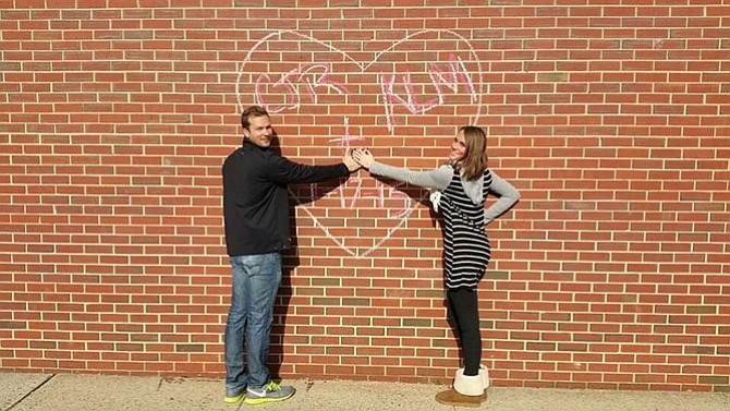 Chris Rowson proposes to Kellie McDonald on Saturday, Jan. 17 on the grounds of Fairview Elementary School in Fairfax Station, where the couple first knew each other as students.