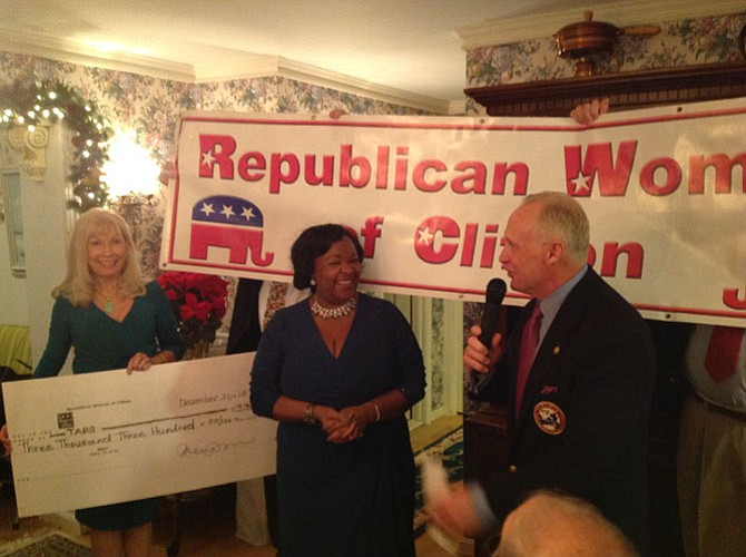 Outgoing President, Alice Butler-Short (left), and incoming President, Leah Durant (center), present Brian Bauman, Director of Special Events, TAPS, with funds donated by Republican Women of Clifton in 2014.